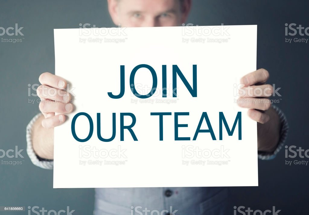 man holding sign with words Join Our Team stock photo