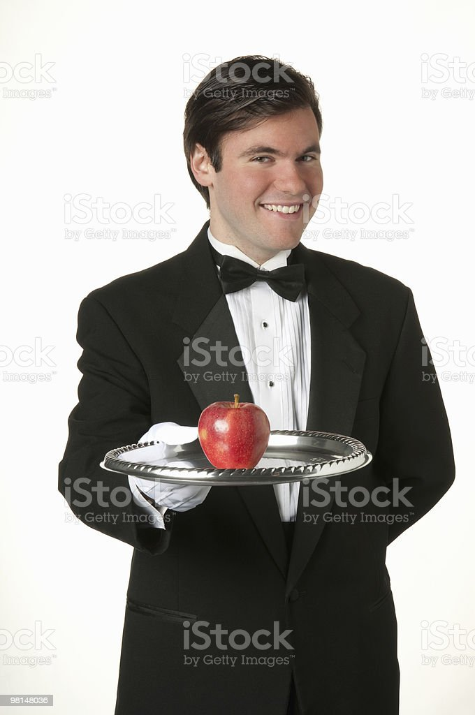 man holding silver tray with apple royalty-free stock photo