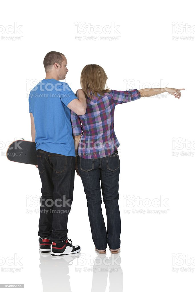 Man holding skateboard standing with a woman royalty-free stock photo