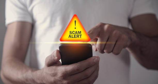 Man holding smartphone. Scam Alert Man holding smartphone. Scam Alert alertness stock pictures, royalty-free photos & images