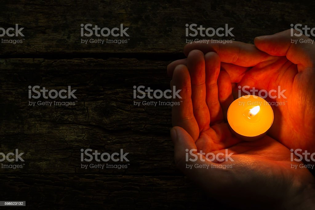 man holding spa candle stock photo