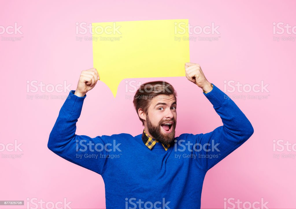 Man holding speech bubble or thought bubble stock photo