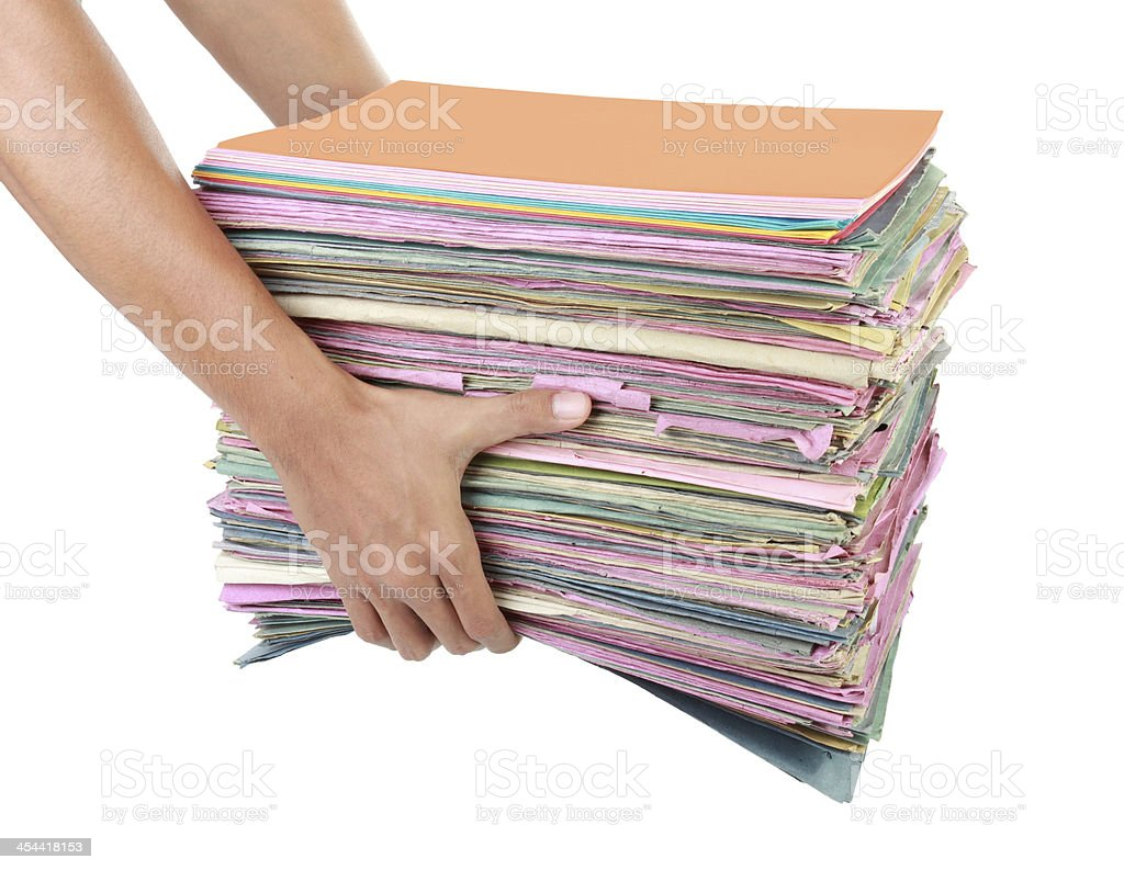 Man holding stack of folders pile with documents and bills royalty-free stock photo
