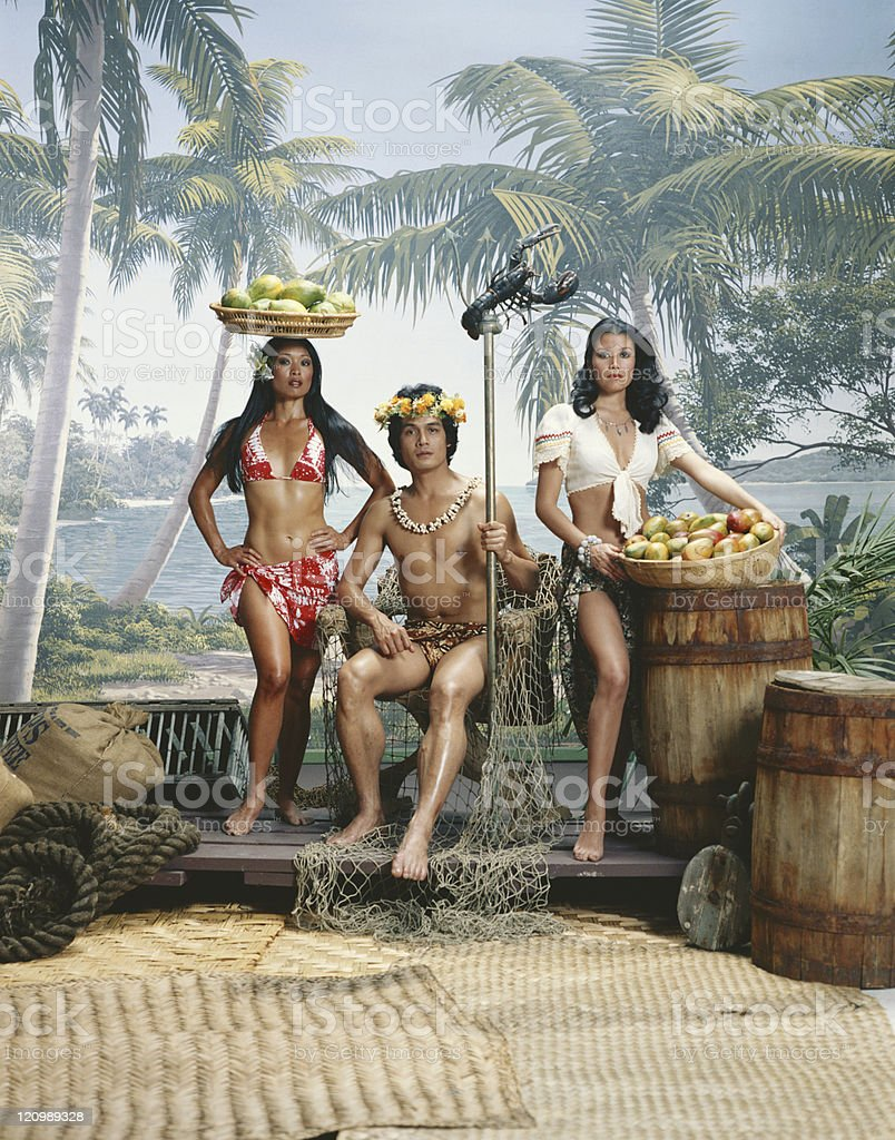 Man holding stick and woman with basket of fruits, portrait  royalty-free stock photo