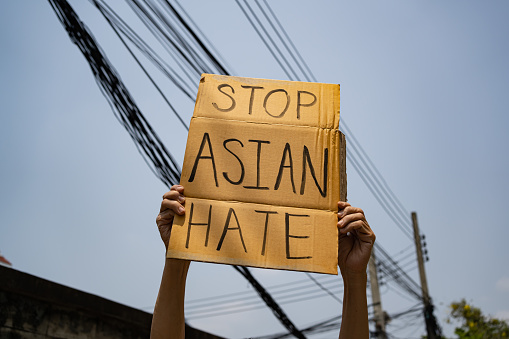 A man holding Stop Asian Hate sign