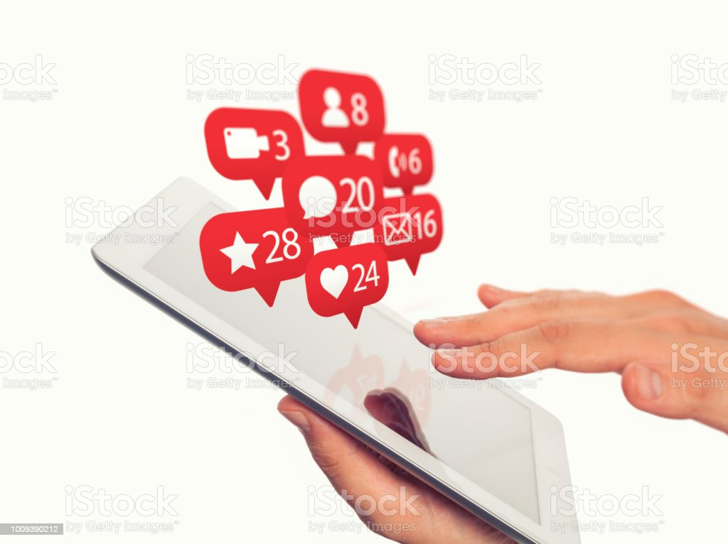 man holding tablet computer and notifications icons of social network flying over display stock photo