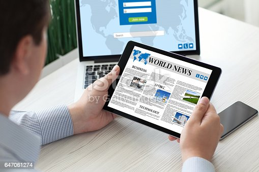 istock man holding tablet computer world news with notebook phone 647061274