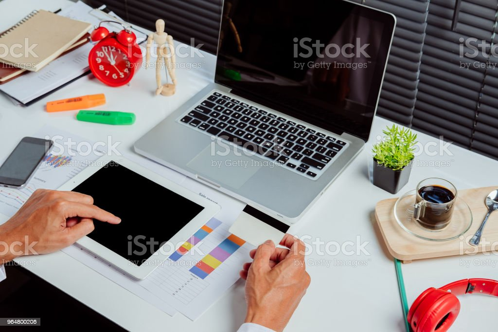 Man holding tablet pc and credit card royalty-free stock photo