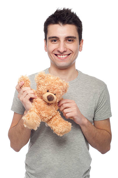 Man holding teddy bear stock photo