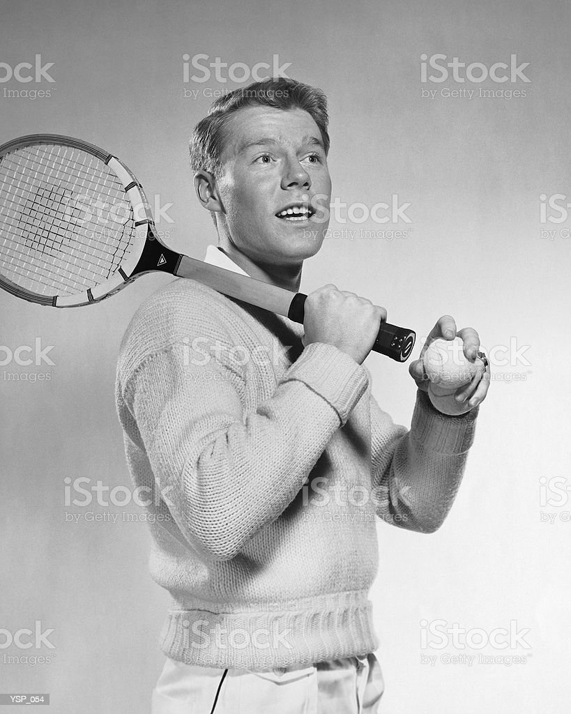 Man holding tennis racket over his shoulder royalty-free stock photo