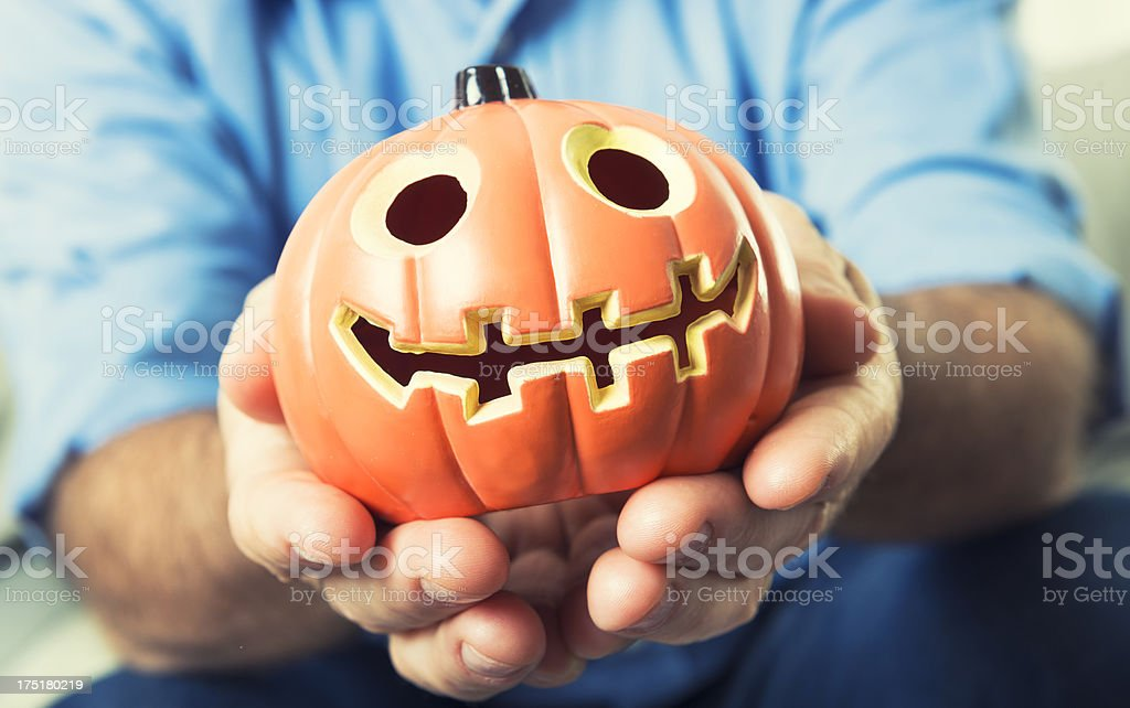 Man holding the jack O'Lantern Pumpkins - Halloween decoration royalty-free stock photo