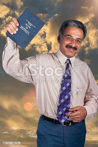 man holding the Mormon holy book