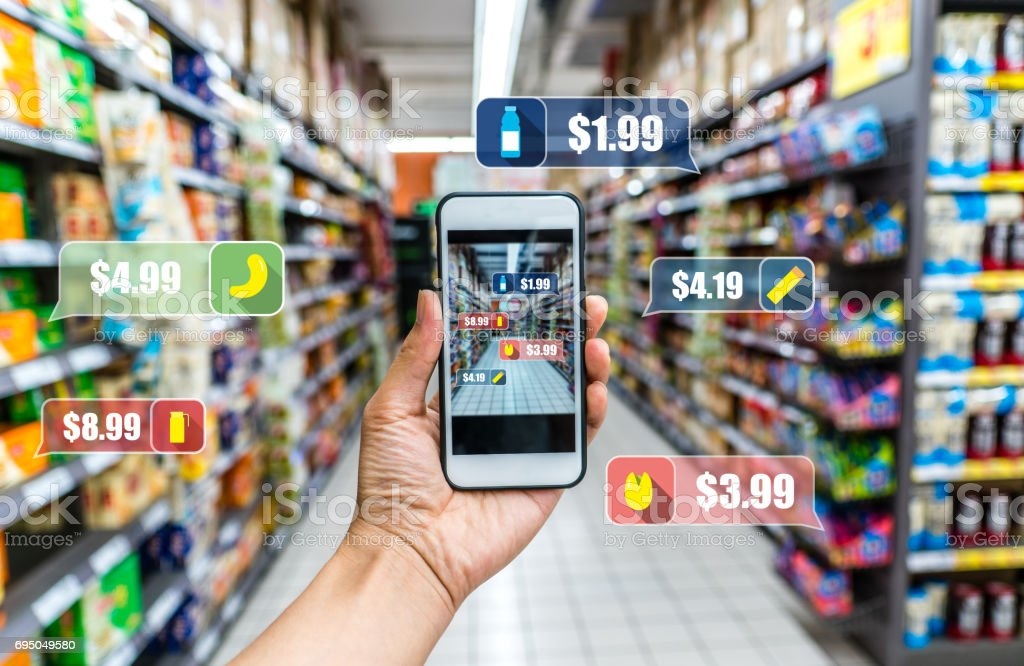 man holding the smart phone, using the Augmented Reality buy some food in the supermarket stock photo