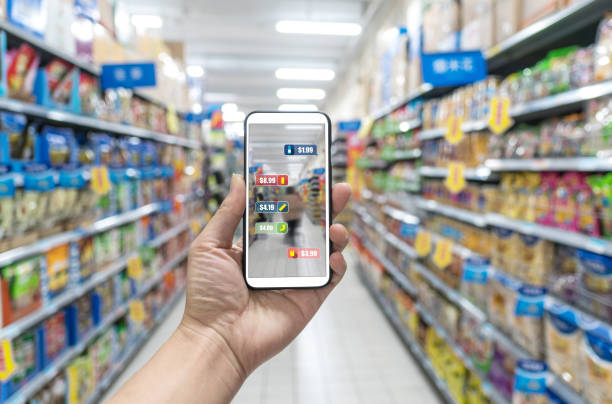 man holding the smart phone, using the augmented reality buy some food in the supermarket - augmented reality stock photos and pictures