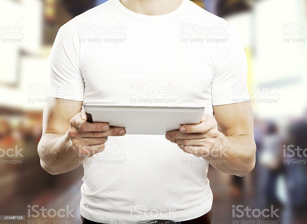 man holding touch pad stock photo