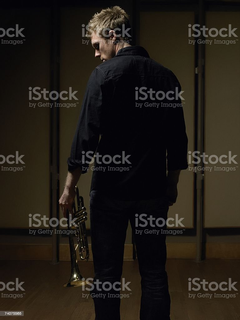 Man holding trumpet royalty-free stock photo