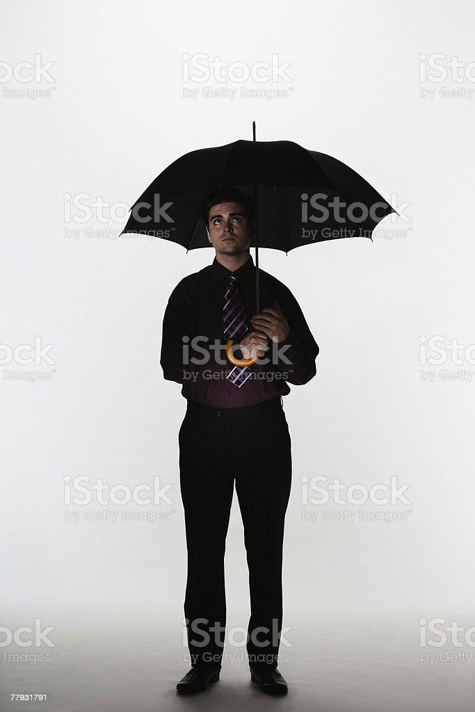 Man holding umbrella royalty-free stock photo