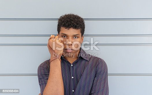 istock man holding up forearm with leather wrist band 839368494