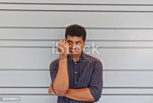 istock man holding up forearm with leather wrist band 839368620