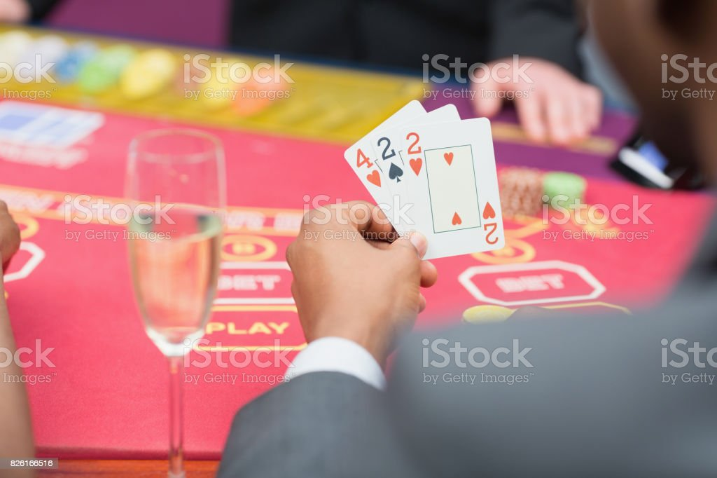 Man holding up poker hand stock photo