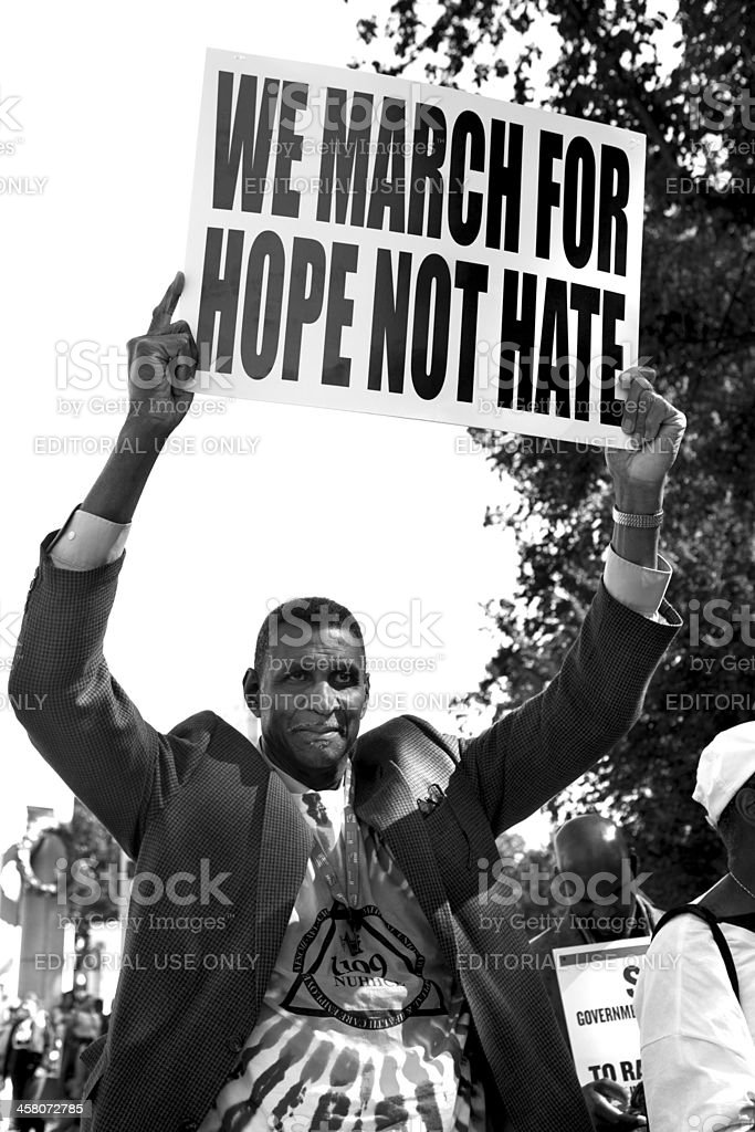 Man holding up protest sign stock photo