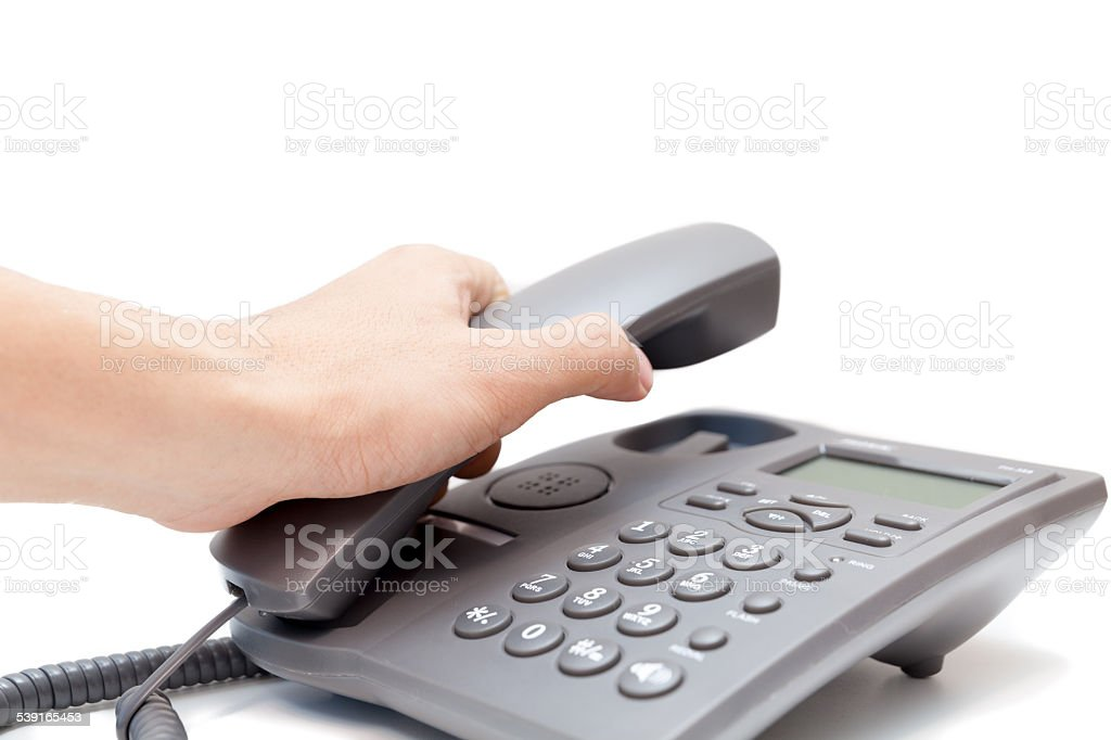man holding up the phone receiver stock photo