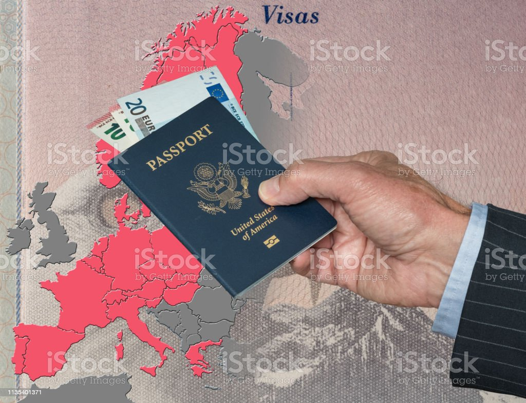 Man Holding Us Pport And Euros On Map Of Schengen Zone ... on printable labeled united states map, man with map, man in america map, the man in the map, usa map, man tracking, man u smap, black population in america map, man united states, mimal on the map, pink map, u.s map, man in the mississippi, man island england, the man on the map, douglas isle of man map, iom map, man in trunk, dude in the map, syria map,