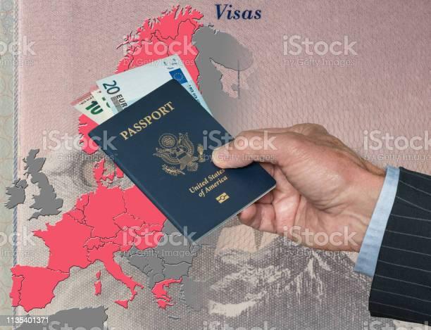 Man holding us passport and euros on map of schengen zone picture id1135401371?b=1&k=6&m=1135401371&s=612x612&h=ons0e6sfvw5ppclcmk38ffi99zkzci1lh9ddxkrscgi=