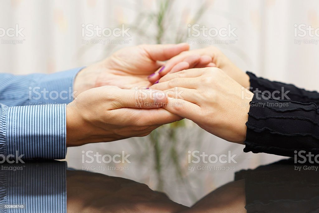 man  holding woman hands. love and care concept stock photo