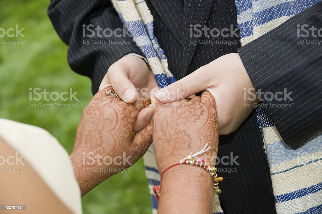 man holding woman's hands at a wedding ceremony stock photo