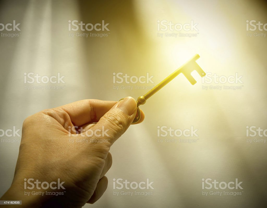 Man holds a key stock photo