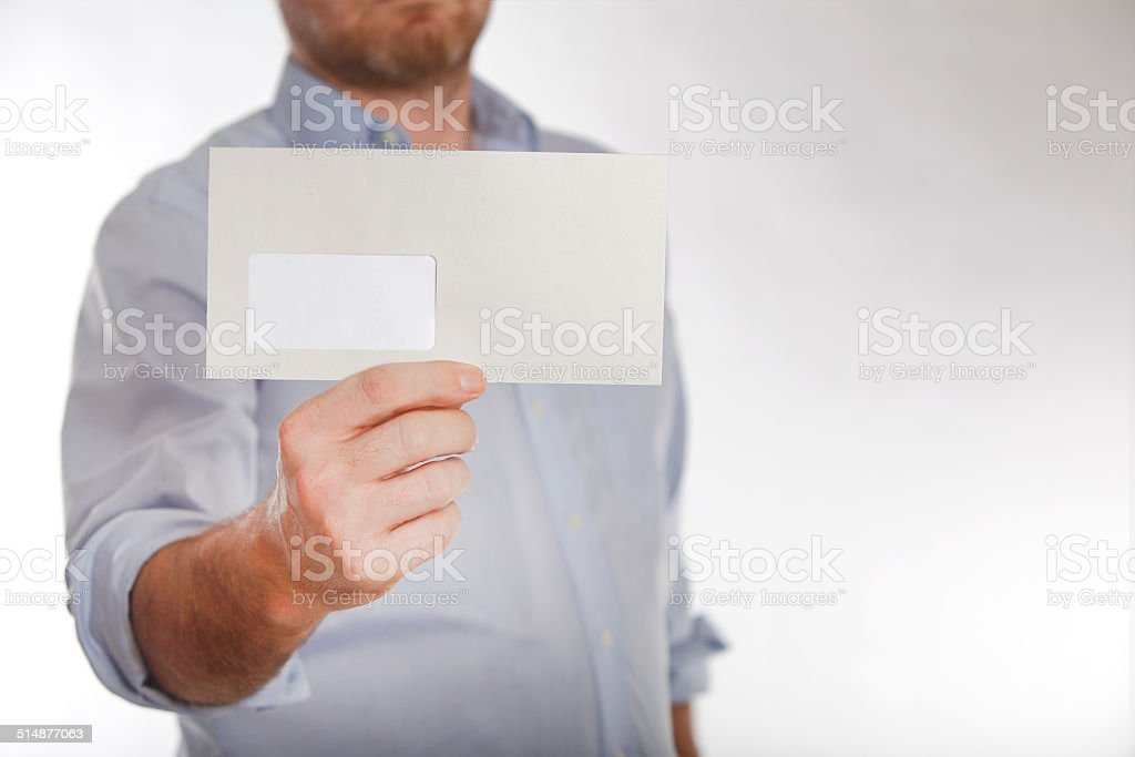 Man holds a letter into the camera stock photo