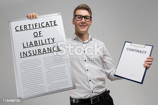 863128060 istock photo man holds a poster with inscription certificate of liability insurance and an empty certificate isolated 1134997261