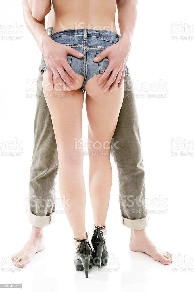 man holds a woman's buttocks stock photo