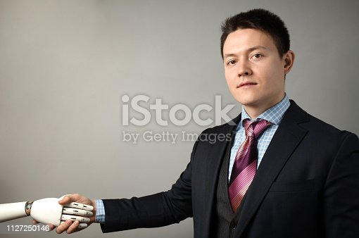 istock Man holds artificial limb for disabled people. Prosthetic arm 1127250146