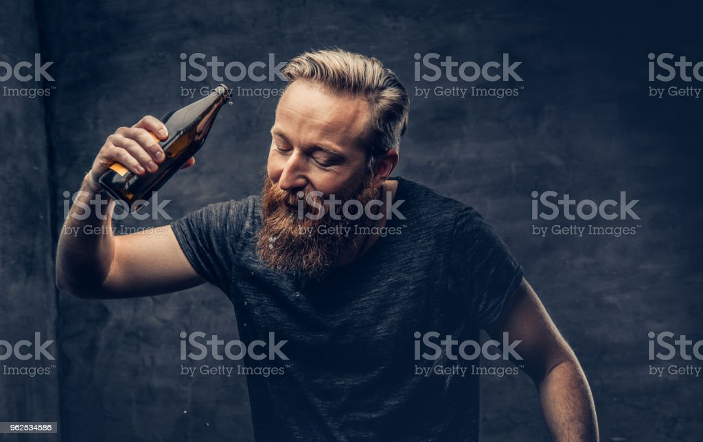 A man holds beer bottle. - Royalty-free Alcohol Stock Photo