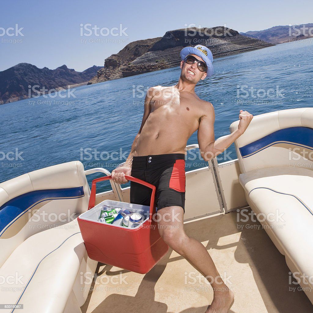 Man holds cooler on boat royalty free stockfoto