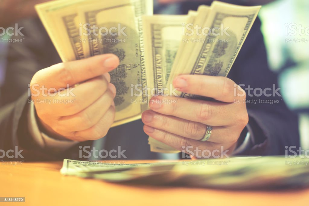 Technology Management Image: A Man Holds Dollars In His Hands Businessman Holding Money