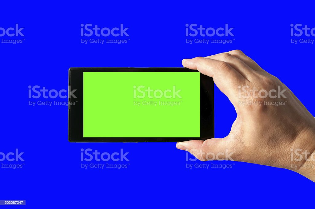Man holds in hand touchscreen tablet with chroma key stock photo