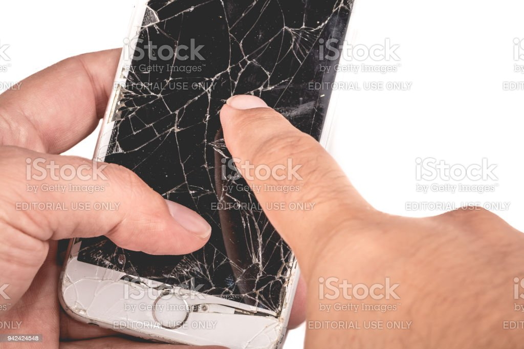 A man holds in his hand an iphone 6S of Apple Inc stock photo