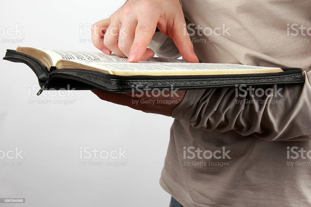 man holds in his hands an open book royaltyfri bildbanksbilder