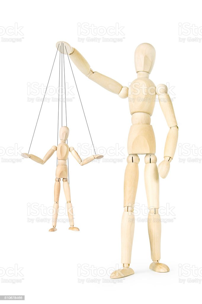 Man holds in his hands the marionette on threads stock photo