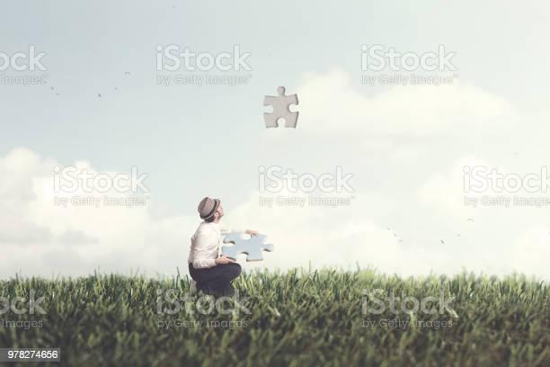 Man holds piece puzzle shape of sky picture id978274656?b=1&k=6&m=978274656&s=612x612&h=u0gmt6xcter8wazbktyibzqkujspfyky efsfi6frv4=