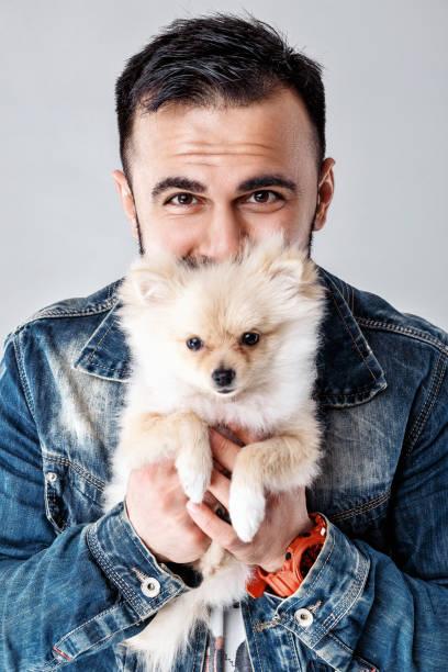 Man holds pomeranian dog picture id950822188?b=1&k=6&m=950822188&s=612x612&w=0&h=mkuhzxmruqvh1go9j70b6xijwp7epnik9rkt xyt0to=