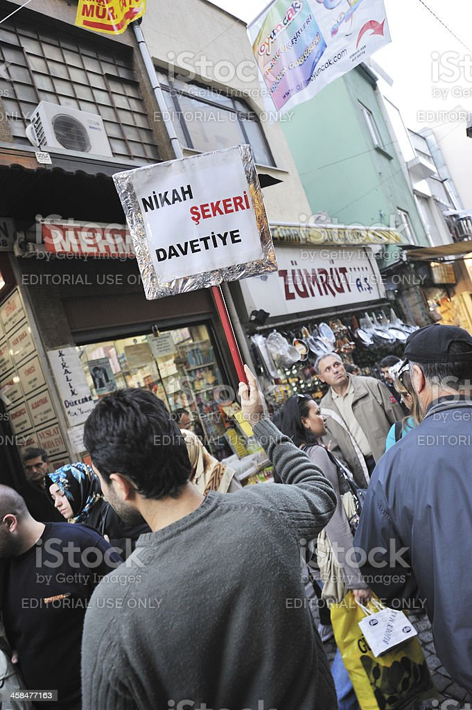 Man Holds Sign for Wedding Services in Istanbul royalty-free stock photo