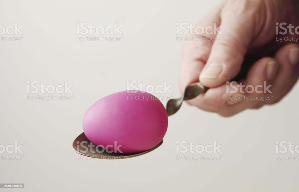 Man holds spoon with Easter egg royalty-free stock photo