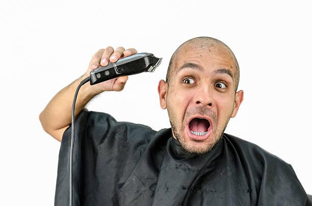 man holds the trimming machine and beautify yourself - glatze schneiden stock-fotos und bilder