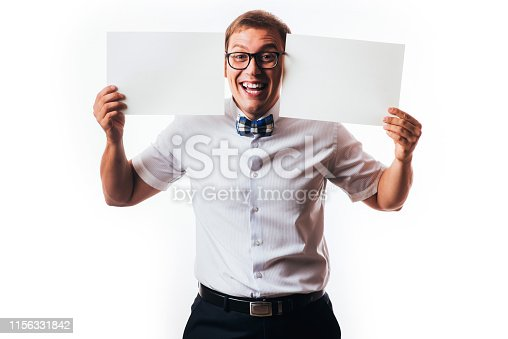 istock man holds the white sign in a studio white background 1156331842