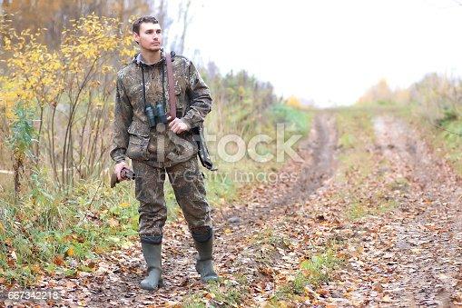 istock man hunter outdoor in autumn hunting 667342218