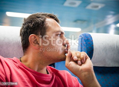 man traveler hushing someone on the airplane
